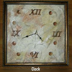 TITLE : Embossed Modern Art.MEDIUM : Acrylic and ink on paper.The clock has earthy colours and is painted on embossed paper.It has roman numerals artistically drawn.The clock is designed in such a way that it can be put on the wall as well as placed on tables.