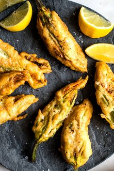 NYT Cooking: Zucchini blossoms are a thing of wonder. They are great raw, in a salad, with a drizzle of good olive oil, but when they are coated in a crisp batter and stuffed with a light filling, they are an otherworldly experience. To get a good batter that isn't too thick or oily, ensure that your sparkling or soda water is very well carbonated and ice cold. Also take your time with the oil, testing it a...