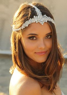 Designed by Doloris Petunia, this glamorously bohemian hair chain is made to order with hundreds of Swarovski crystals in the hand-dyed color of your choice. Here, it is shown with a mix of clear and opal crystals and silver accents.