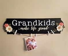 Simple tutorial for how to make a colorful Grandkids Make Life Grand wood sign that also doubles as a unique photo display! It's a great DIY gift idea!
