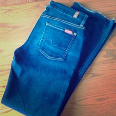 "7 for all Mankind Kimmie Bootcut Jeans 7 for all Mankind Kimmie Bootcut jeans size 30. Nice medium/dark denim. Please note the cut hem (as shown in photo) can be left or finished! Inseam approximately 30 1/2"""". 7 for all Mankind Jeans Boot Cut"