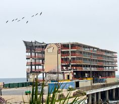 Tearing down the Flagship hotel to make way for restoring the pleasure pier. (after Ike)