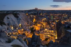 This photo was shot from Cappadocia, Turkey after sunset. The residentails, hotels etc. will turn on the lights. More information about Cappadocia click link below;  http://www.cappadociaturkey.net/