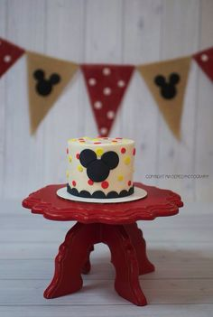 Perfect Mickey Mouse smash cake. Red white yellow and Black.