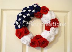 "Patriotc Rose Wreath - The Base of the wreath is made of Eco-friendly felt and stuffed with poly-fill. Measures about 11"" x 11"" .The front measures about 14"" x 14"" . You get 22 felt roses glued to the front of the wreath. Each bloomed rose vary in size but they are approx. 4"" x 4"".  $106 - Worth it considering the time it took to make this!"