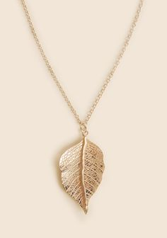 Leaves have many different interpretations, why not add a new one to the list when you add this leaf necklace to an adorable outfit?