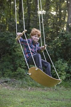 The Swurfer Original Outdoor Backyard Tree Swing with Unique Skateboard Seat Design, Durable Rope, and Adjustable Handles