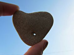 A Tiny Hole In The Heart You just take the human heart and you click back the cover.  Underneath the cover, next to the battery is a tiny hole the size of the universe.  You take a paperclip and you straighten it out, like someone you love would help straighten you out.  You push it through your soul first and remember that you're piercing it to remind yourself to feel.  Then you push the paperclip into the tiny hole the size of the universe.  You wait until all the stars blink three times…