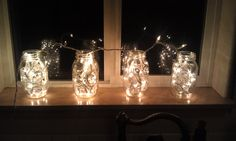 This is a simple idea!! All you need is a strand of Christmas Lights and 3 or 4 Mason Jars. Set the Mason Jars on a window ledge and evenly distribute the lights inside of them. Last plug in the lights and you will have an instantly beautiful Christmas decoration.
