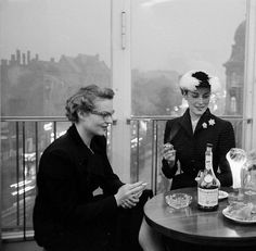 Ladies who lunch (and smoke) in deeply elegant early 50s style.
