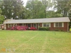 Wonderful view from this four side brick ranch..Enjoy watching the ducks from your mature landscaped front yard.  Three large bathrooms two full baths, separate dining, living room, family room,  sun