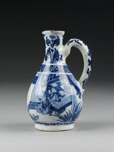 Delft Jug. Lambertus van Eenhoorn, De Metaale Pot, marked LVE / 4. Chinese blue and white porcelain became immensely fashionable in 17th-century Holland as the Dutch East India Company, established in 1602, began to import this exotic product by the shipload. The potters of Delft changed their style and the quality of their product in order to compete with Chinese porcelain. Decorations in Chinese style were applied in cobalt blue on the finest white tin-glaze ground. Jeroen PM Hartgers