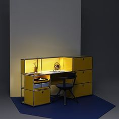 USM Haller E - Light fuels creativity The golden yellow work and charging station boosts the energy in your home office. The barely visible lights embedded in the tubes infuse warm light into your eve
