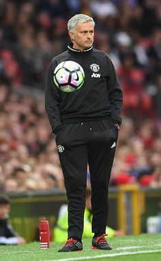 Manager of Manchester United Jose Mourinho looks on as the match ball bounces infront of him during the Wayne Rooney Testimonial…