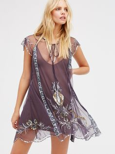 Lady Lazarus Slip | Glam short sleeve sheer mesh slip featuring elegant embellishments and embroidery throughout. Front v-neckline with adjustable tie accents. Sweet scalloped hem.
