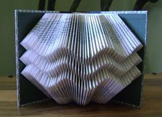 Folded book art ,waves II, recycled book by Dancing Grey Studio.