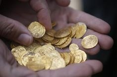 """By Ori Lewis CAESAREA, Israel (Reuters) - Scuba divers have discovered a rare haul of gleaming 1,000-year-old gold coins inscribed in Arabic on the sea bed off Israel, a find archaeologists say may shed light on Muslim rule in that age. The treasure, which was probably exposed during recent winter storms, is thought to have sunk in a shipwreck near the ancient Roman port of Caesarea in the eastern Mediterranean. """"(This is) a great treasure from a (vessel) that was probably taking the hoard…"""