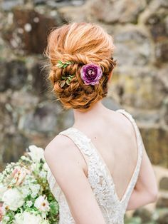 loose twisted bridal updo with sparkly spaghetti strap wedding dress