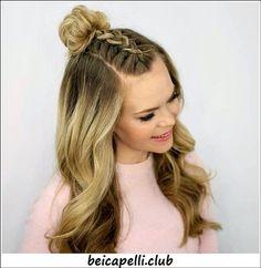 Acconciature capelli lunghi mossi raccolti