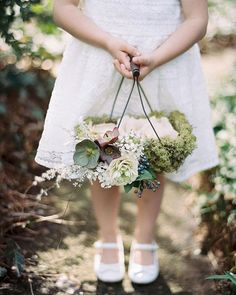 12 Flower Baskets Your Flower Girl Will Love LOVE this mossy basket with wire handles. and those hellebores! Intertwine 12 Flower Baskets Your Flower Girl Will Love LOVE this mossy basket with wire handles. and those hellebores! Flower Girl Basket, Flower Baskets, Love Flowers, Wedding Flowers, Basket Flower Arrangements, Wedding Venue Inspiration, Wedding Ideas, Space Wedding, Wedding Styles
