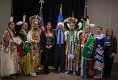 Bernie Sanders and Native American policy advisor, Nicole Willis, to the right of Sanders, pose with the Great Plains Dance Company in Sioux Falls, South Dakota. At far right is Sanders's wife, Jane Sanders. Courtesy Bernie Sanders campaign.