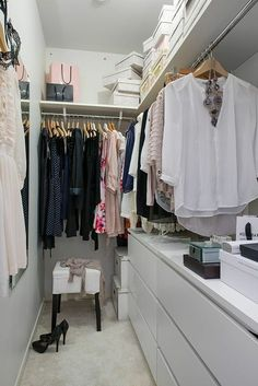 Gorgeous mini walk-in closet inspires envy in us for two reasons. First, there's her neatly hung and stacked clothes. Second, all organizers is nice within a united color scheme of white.