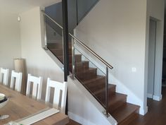 Glass railing mounted on diagonal wall.