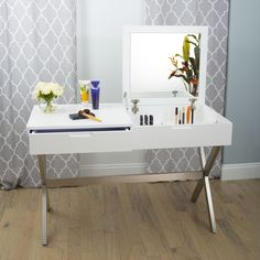 A little vanity goes a long way. Doubling as a chic work desk, lift up the hinged top to reveal a convenient mirror and room for all your fashionable accessories. The second hidden drawer is the perfect place to store your laptop or other home office essentials.
