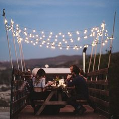 The only way to dine...with good people, bistro lights, and flatbed trucks. Brainchild of @laceandlikes for @crawforddenimandvintage ~ back of flatbed truck picnic | Renata Stone