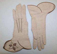 Gloves Date: 1950s Culture: German Medium: cotton Dimensions: Length: 11 in. (27.9 cm)
