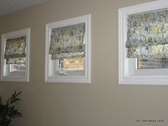 Roman shades as window treatment for small square windows