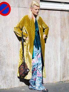 Hanne Gaby Odiele wearing a Dries Van Noten gold velvet coat.