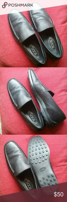 """Tod's Black Driving Loafers Great condition, not sure they've ever been worn. These have the """"driver"""" soles but they're a bit more formal than the usual Tod's driving mocs. Sizing is funky so compare your foot to these measurements before you buy. They are labeled size 8.5 but they are really a 10.5/11. Measurements: sole is just under 12"""".from heel to toe. Toe box (widest part of the upper) is 4"""". As is due to sizing. Tods Shoes Loafers & Slip-Ons"""