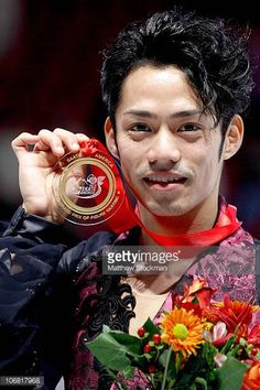 Daisuke Takahashi of Japan poses for photographers after winning the men's program during Skate America at Rose Garden Arena on November 13 2010 in...