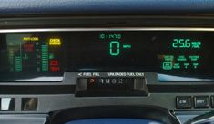 Digital dashboard cluster of a Mercury Grand Marquis. The cluster features three VFD displays (left third, middle third and right third). Varying colors are emitted through color filters. Hybrid Trucks, Digital Dashboard, Dashboard Car, Car Ui, Car Audio Systems, Futuristic Cars, Dashboards, Ford Gt, Retro Cars