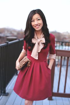 Casual holiday: Red party dress with tie-neck blouse layered underneath.