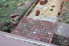 A few months ago, Dave and I had a spontaneous moment and decided to repave our front walkway with antique brick. It was mid-March and the. - Gardening In Lights Brick Walkway Diy, Brick Paving, Paver Walkway, Front Walkway, Cobblestone Walkway, Walkway Ideas, Brick Sidewalk, Front Sidewalk Ideas, Pathways