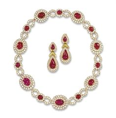 A RUBY AND DIAMOND 'VERLAINE' NECKLACE, BY VAN CLEEF & ARPELS, AND A PAIR OF EAR PENDANTS