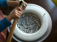 Hammering golf tees into styrofoam.  Real life tools.   Repinned by Apraxia Kids Learning. Come join us on Facebook at Apraxia Kids Learning Activities and Support- Parent Led Group.