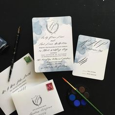watercolor crest monogram wedding invites | Smitten on Paper