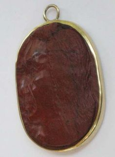 Red Jasper hard-stone cameo of Nez Perce Indian brave mounted in gilt bronze