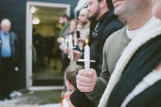 candles held by guests at intimate ceremony