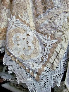 Layers of Collaged Vintage Lace and Doilies to create a Quilt