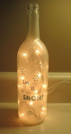 Diy Let It Snow Lighted Wine Bottle crafts - snowflake, lighting, table decoration Painted Wine Bottles, Lighted Wine Bottles, Bottle Lights, Bottles And Jars, Plastic Bottles, Liquor Bottles, Glass Bottles, Wine Bottle Corks, Glass Bottle Crafts