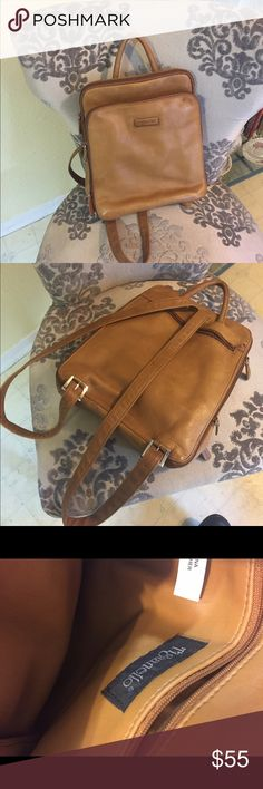 Tignanello leather backpack Never carried beautiful soft leather. Has lots of pockets with zippers and dividers. Inside is pristine. Tignanello Bags Backpacks