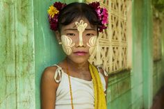 Tanaka is the traditional sunscreen/makeup for most women and kids in Burma. Specially the kids come up with decorative make ups. The paste, grind form a tree bark, helps to protect and moisturize the skin against the blistering sun.