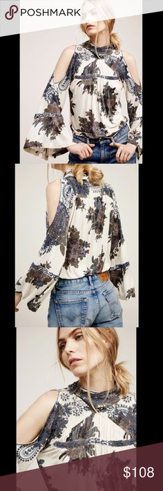 """Free People Cold Shoulder Floral Bell Sleeve top M Free People tan Embroidered Cold Shoulder Paisley Floral Bell Sleeve Top soft jersey floral printed top with beautiful paisley embroidery cold shoulder cut outs on bell shaped sleeves adds a retro touch elastic band at the waist * high neckline with crossed back & 2 button neck New Without Tags  *  Size:  Medium retail price:  $128.00  * there is a black line through the tag to prevent store return  73% viscose* 13% linen  44"""" around bust…"""