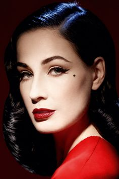 Dita Von Teese queen of burlesque. Her vampy look works so well, definitely the kind of look I want to go for.