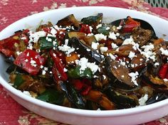 Grilled mediterranean vegetable salad has grilled eggplant, zucchini, red peppers, and potatoes are tossed with Greek vinaigrette,and topped with feta