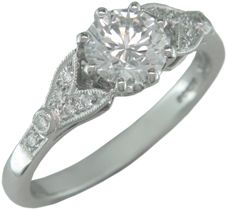Antique engagement ring design with diamond-set floral motif